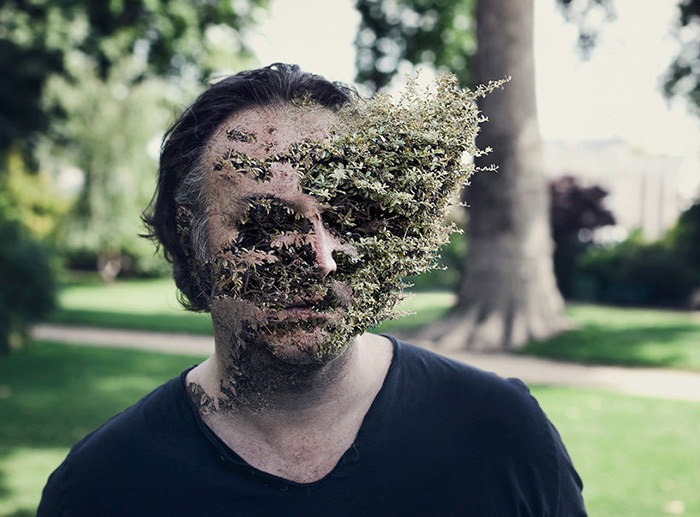A man whose face appears to be turning into a plant
